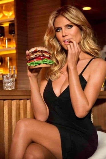 """Have you ever been seduced by a burger before? After this commercial, ya just might,"""" says Heidi Klum of 'Carl's Junior and Hardee's Jim Bean Bourbon Burger'. The 39-year-old German model turned Mrs Robinson for a burger-based recreation of a scene from 'The Graduate', all in the name of promoting those mouth-watering 920 calorie meat-filled buns."""