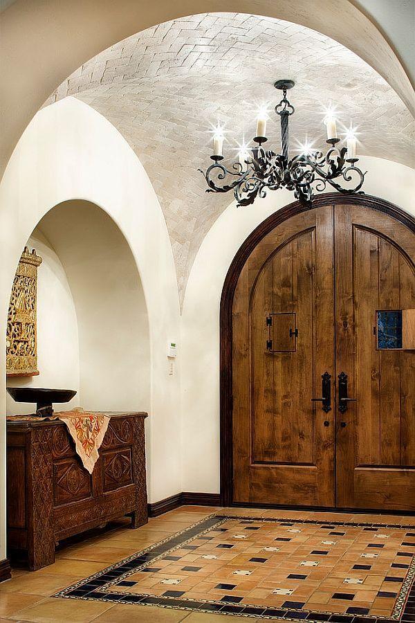 Jauregui Architecture Interiors rustic Spanish interior scheme for Lake Conroe Residence Hometone