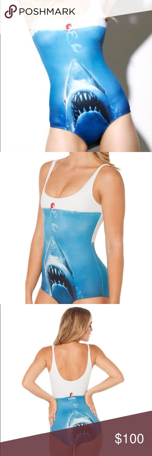 Black Milk Shark vs Mermaid Swimsuit Disney Ariel Great used condition, is a size Long torso large. Description: Mermaids and sharks ... they both live in the ocean. It was only a matter of time before their worlds collided - with tragic consequences. Yeah, try singing your way out of that one, darling.  Composition: 82% Polyester, 18% Elastane Washing: Machine wash cold, gentle cycle with like colours Made in: Australia Blackmilk Swim One Pieces