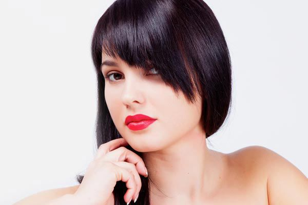"""Cut your angled bangs in wispy or choppy layers to create a cute and flirty style. This softer angled bang style will add just the right touch of sweet sophistication to your haircut."" Shannon Boyce"