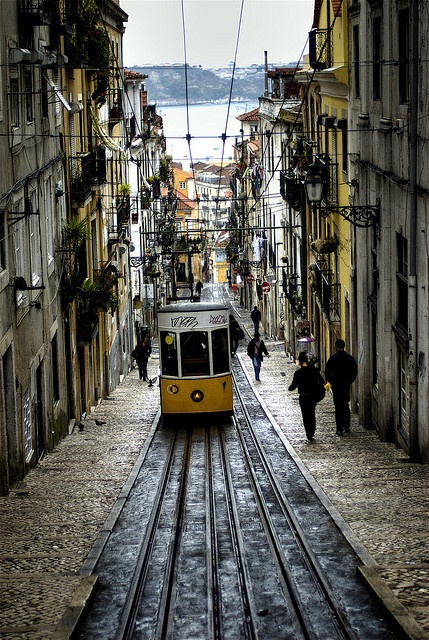 Tram on a hilly street in Lisbon, Portugal