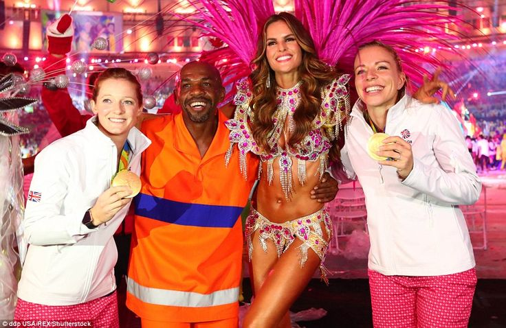 Golden era: Team GB athletes pose with a flamboyant dancer during the closing…