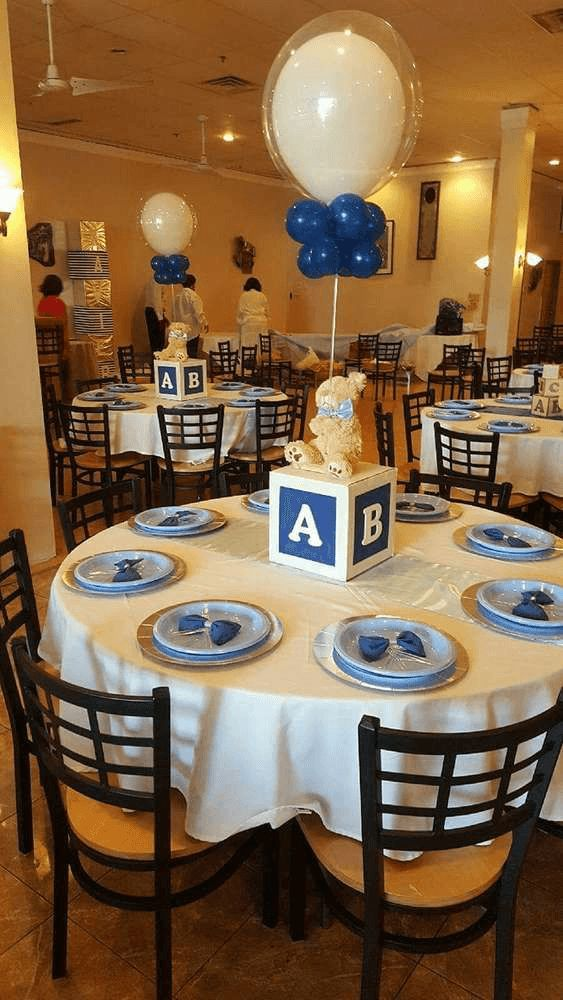 23 Easy-To-Make Baby Shower Centerpieces & Table Decoration Ideas Easy-to-make blue balloon, baby block baby shower centerpiece!