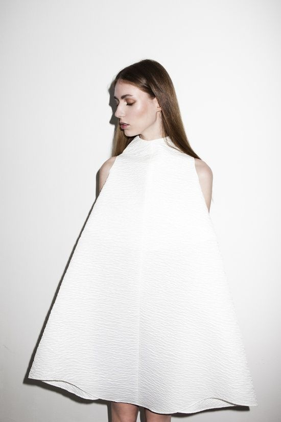 Minimalist Fashion - structured white dress with sharp silhouette & subtle textures; elegance in simplicity // Sabela Tobar