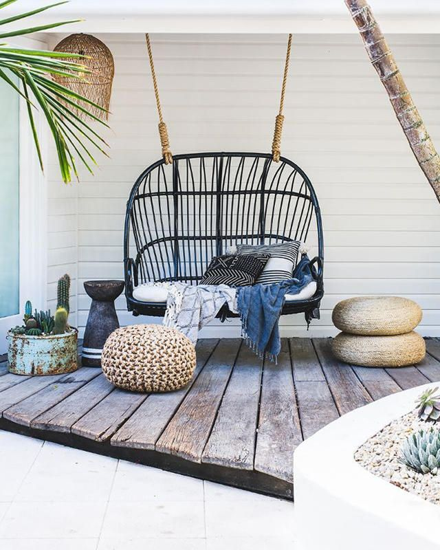 Make the most of your front porch with these ideas on how to design and makeover your space into an entertaining oasis-hang this rattan chair and add poufs, floor pillows and cacti for a chic Southwestern vibe.
