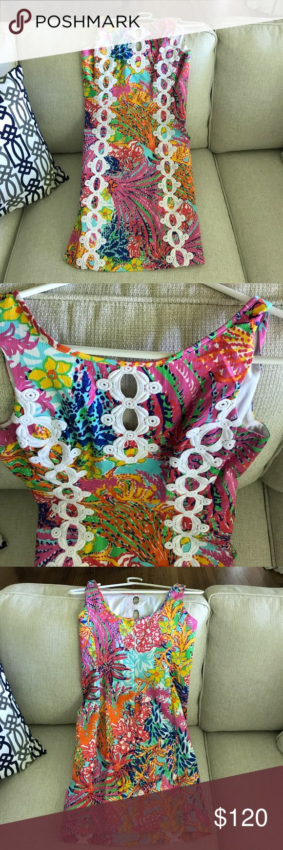Gorgeous Lilly Pulitzer shift dress size 0 Worn once, pristine condition!!! Lilly Pulitzer shift dress size 0. Gorgeous bright color and pattern with white crochet. Zips up and scoops in back. Lilly Pulitzer Dresses