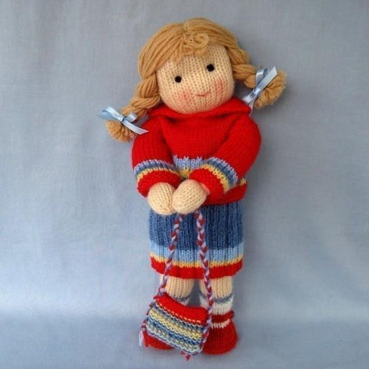 Tilly - Knitted Doll toy pattern with cute clothing and purse - find the pattern on LoveKnitting!