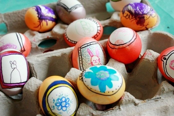drawing on easter eggs with the kids