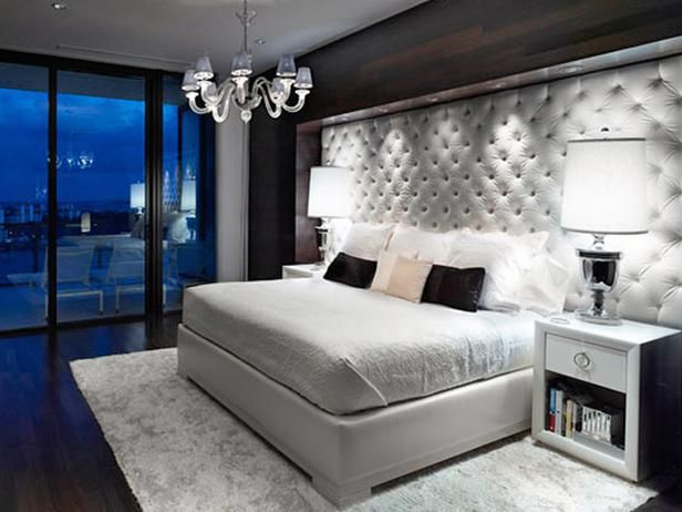 Oversized tufted headboard adds major impact to this bedroom. I love how clean and high fashion this room looks.