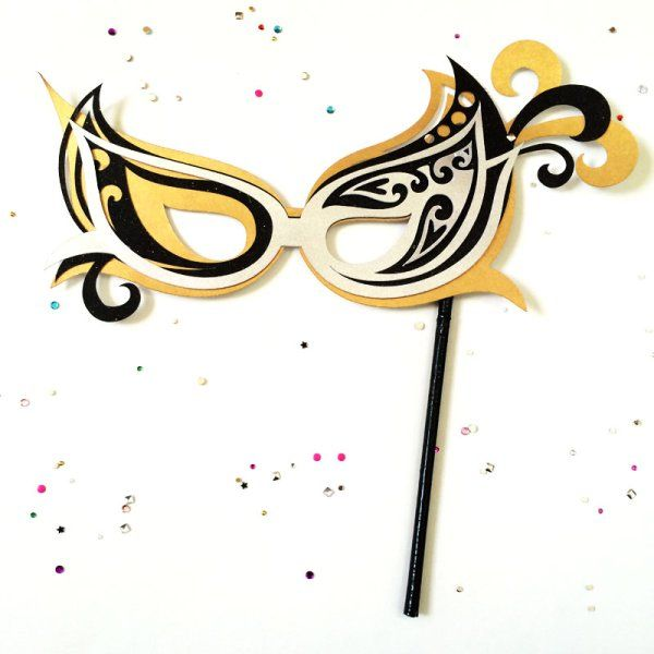 Make this Pretty mask for New Years!  Super easy and you can customize with your own colors. Make this Masquerade Mask designed by Jen Goode and created with Cricut Explore!