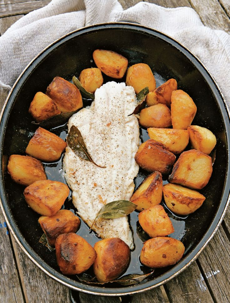 Roast fish fillets with roast potatoes recipe from River Cottage Every Day by Hugh Fearnley-Whittingstall | Cooked.com