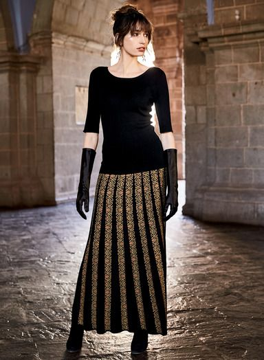 Jacquard knit in arabesques of black, camel, blush and jade pima. Our skirt is engineered from a narrow patterned waistline, releasing into flared black gores to a twirlable hem.