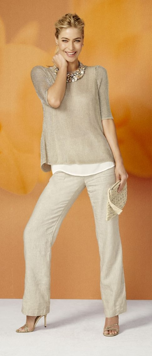 Turn heads in this layered shimmery sweater. It's finished with a stylish split back.