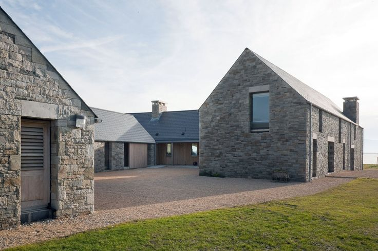 House in Blacksod Bay by Tierney Haines Architects, pavilions form a courtyard enclosure