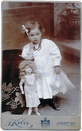 A little doll of a girl standing next to her dolly. Big Doll by josefnovak33, via Flickr