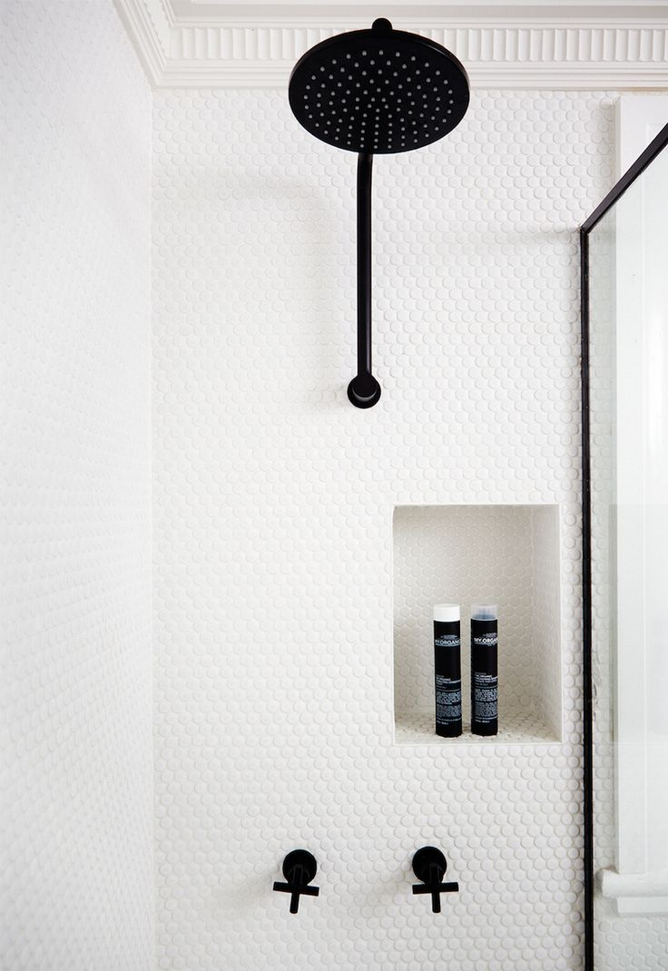 Transitional #bathroom with white penny #shower tile + black fittings