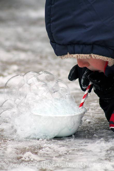 Blow bubbles and watch them freeze - one of the 20 fun winter activities to do with your kids on a snow day.