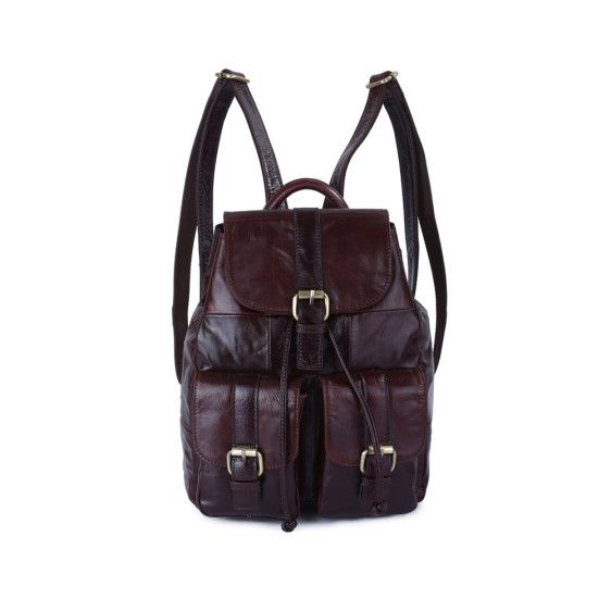 The Dark brown Leather Backpack for women is made from genuine durable cowhide leather features double adjustable straps and gold tone hardware. The inside is lined with fabric and has zip closed pockets and additional pockets for phones and wallets.
