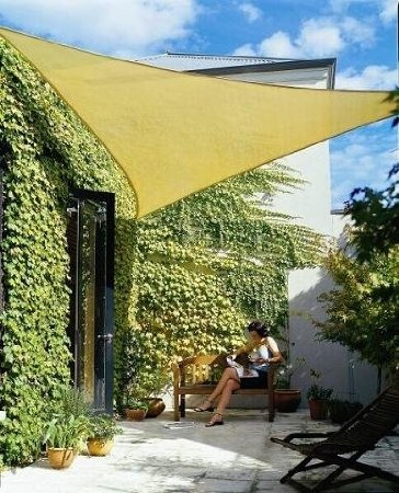 these shade preservers can save your yard if its a huge opening, but creates an inviting area as well. wonderful things.