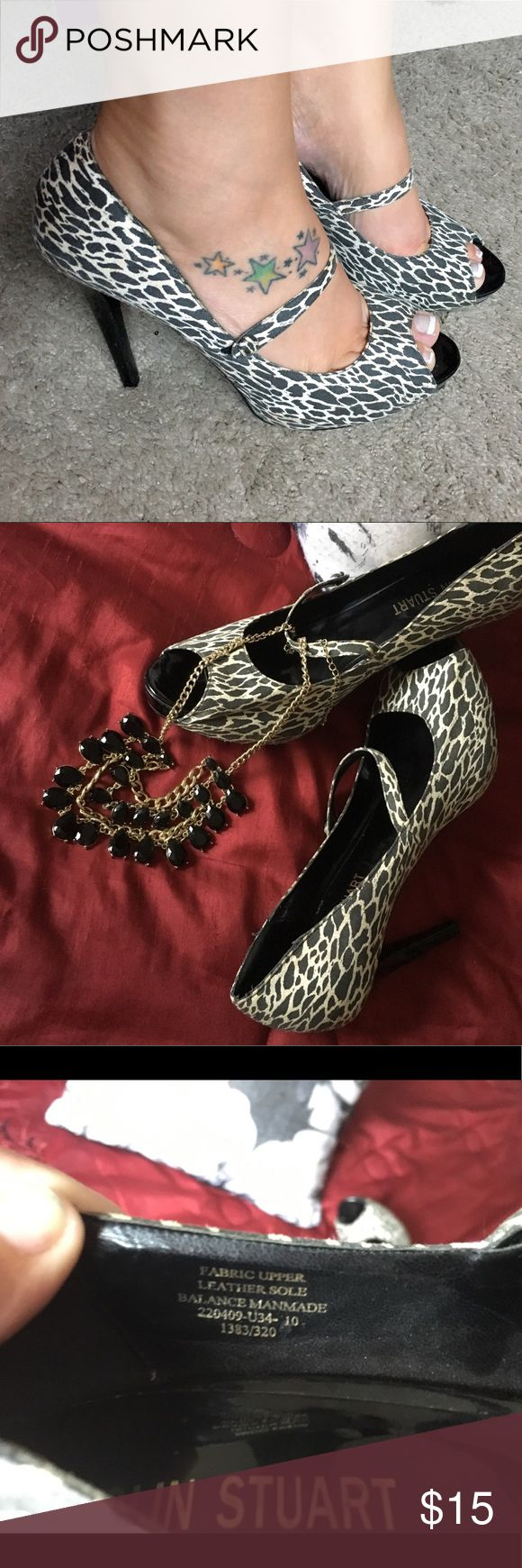 """Colin Stuart 5"""" heels GUC *FINAL MARKDOWN* Colin Stuart women's print 5"""" heels, size 10, these heels are so hot 🔥 I wore them a handful of times back in my days of modeling and wearing heels daily. I didn't clean them they've just sat in my closet being unloved! They do fit pretty good and I usually wear a 9 1/2 in heels, the strap at the top actually keep your foot in place even if the fit is off! Thanks for looking! Colin Stuart Shoes Heels"""