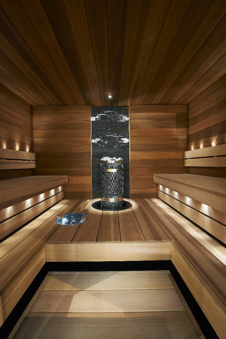 Beautiful dark, moody sauna with subtle small lights under the benches and pointing upward. What a beautiful place to relax and sweat. Love saunas