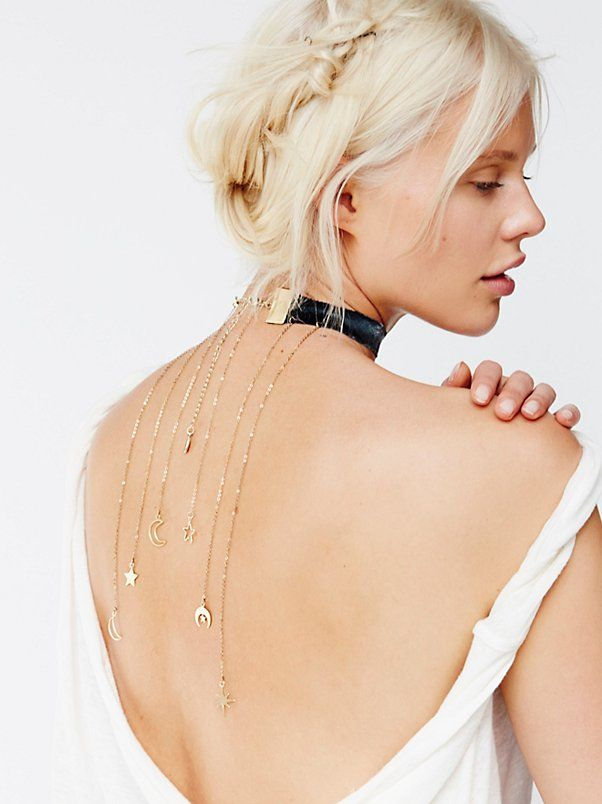 Constellation Velvet Backdrop Choker | American made velvet choker with unfinished trim dripping with statement metal fringe with constellation-inspired charm detailing that is meant to be worn in the back. Adjustable lobster clasp closure.