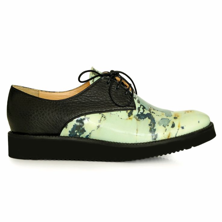 Rust inspiration flats made from natural black leather and printed leather…