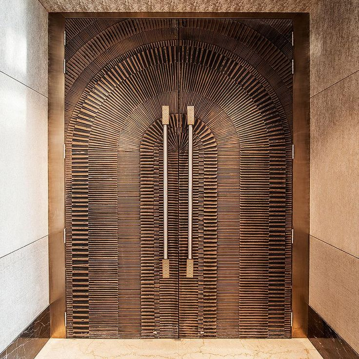Doors In Bonded Bronze With Dark Patina And Eclipse Pattern At JW Marriott Hotel Mumbai Sahar
