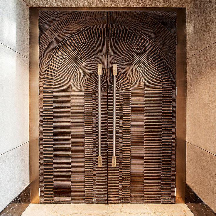 Doors in Bonded Bronze with Dark patina and Eclipse pattern at JW Marriott Hotel Mumbai Sahar, Mumbai, Maharashtra, India