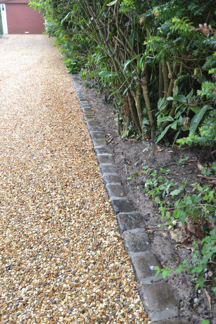 Reclaimed setts for edging of stabilised gravel driveway