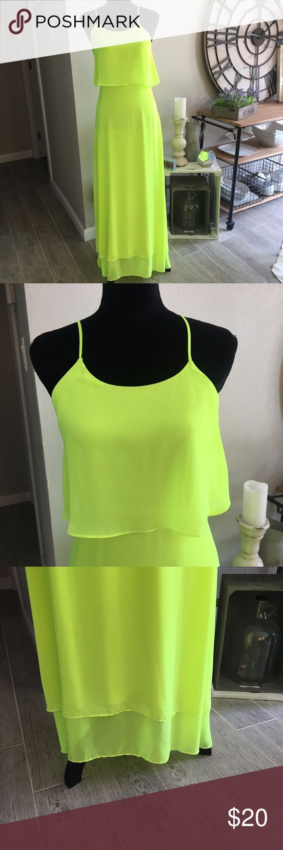 """Gianni Bini Bright Neon Green Dress Size 4 Bright Neon Green Racerback Maxi Dress. Gianni Bini size 4.Only flaw is the front right strap is starting to come off seam. Easy fix with a little bit of sewing and good as new. Flaw is pictured. 100% Polyester. Zipper on side.  Armpit to Armpit - 17"""" Length - 56.5""""  (A) Gianni Bini Dresses"""