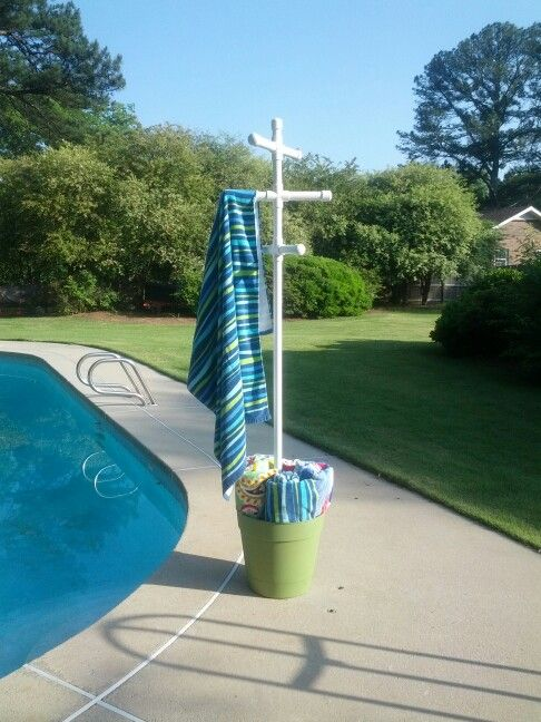 I hate wet towels so I made a pool towel tree from a plastic pot, pvc and quickcrete...also made matching tables for storage.
