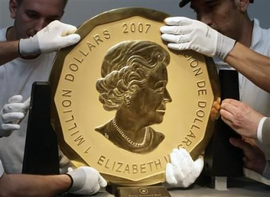 The Maple Leaf coin measures 53cm (21in) in diameter, weighs 100kg (200lb) and is listed in the Guinness Book of Records.  It is one of only five Canadian Maple Leaf coins that carry a face value of almost $1m (£660,000) and bears the image of Queen Elizabeth II.