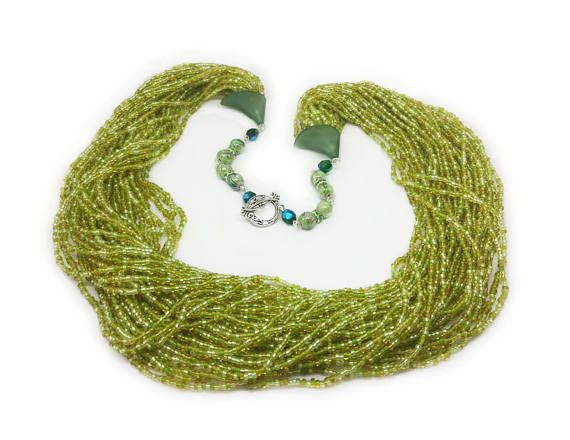 Green and yellow seed beads necklace - Multi layer necklace - Beaded chain  This unique green and yellow seed bead necklace delightful in its simplicity. This delicate necklace will adorn any girl and woman. It reminds the summer and warm days. Elegant jewelry suitable for everyday use and special occasions. Is handmade especially for you.  ◆MEASUREMENTS  The necklace is 29.52 inch (75 cm) Weight 0.418 lb (190 g)  Each purchase comes carefully packaged.  ◆Please note that real colors may…
