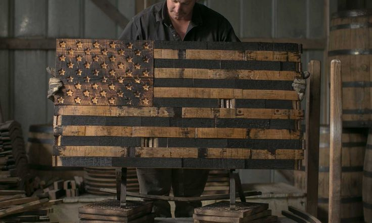 The Heritage Flag Company makes one-of-kind, hand-made wooden American flags out of old whiskey barrels.