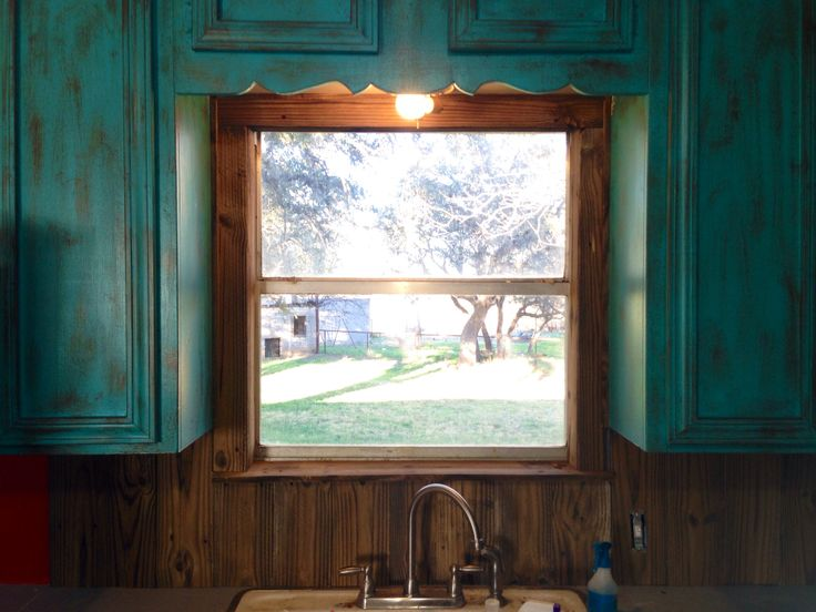 barnwood backsplash to match my rustic turquoise cabinets