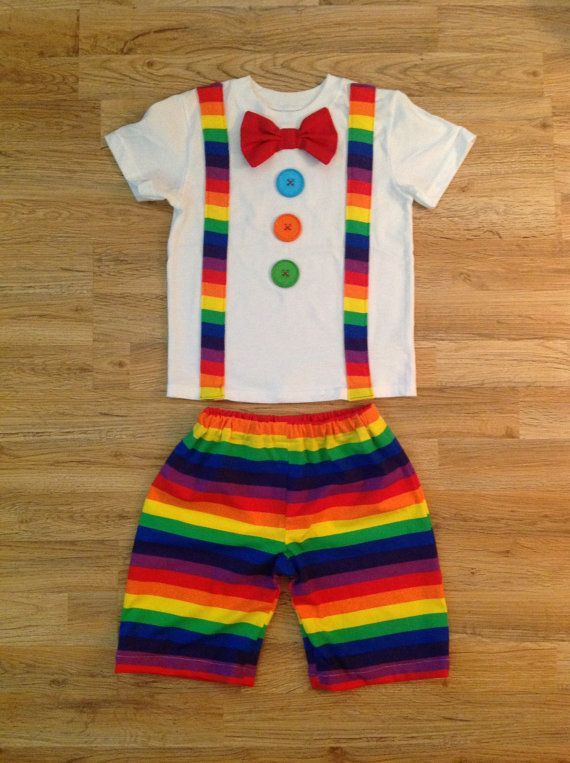 If you would like LONG SLEEVE please specify in the notes to seller section at checkout. This listing is for the perfect birthday outfit or halloween costume for your little clown. Shirt includes Moc suspenders, a red bow tie, and 3 mis matched buttons down the front. Also included is a pair of matching rainbow stripe clown pants. Need a birthday banner or high chair banner to match? A party hat or full smash cake outfit? A Birthday Board? No problem, just message me about your custom…