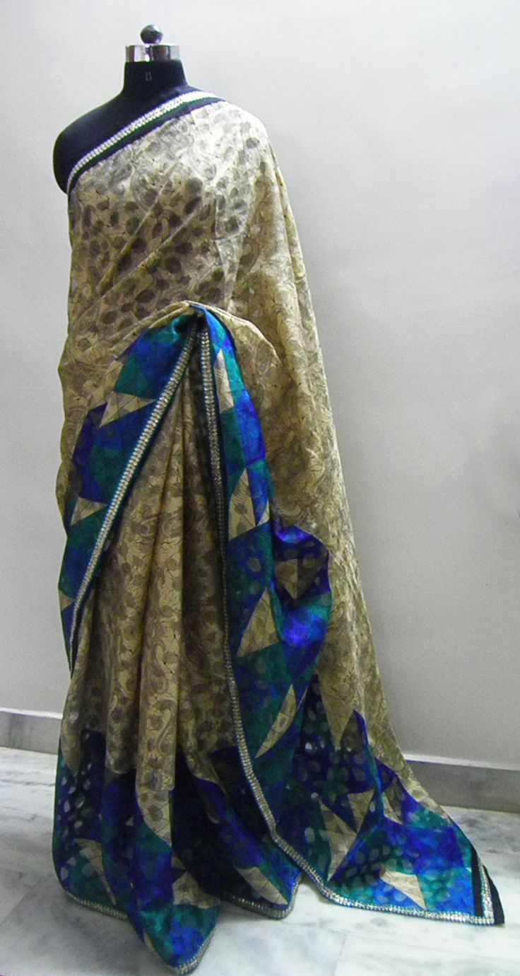 Sari name - Tusser  Tusser fabric with self jacquard design in beige black color along with blue color pattern on allover one side of the saree.  The border has abstract leaf design work lace in Bottle green color and gold.   Fits in all ocassion wear.   Blouse - Blue self pattern blouse fabric   For booking your saree please Email us with Saree name to sales@aaenadesign.com