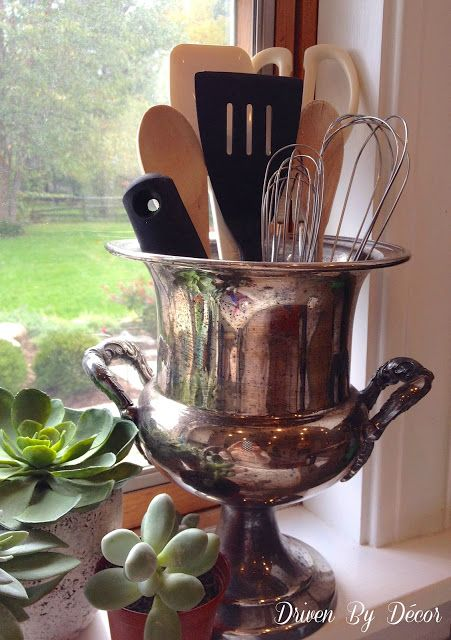 Use a vintage trophy cup or champagne bucket for kitchen utensils - so pretty and unique!