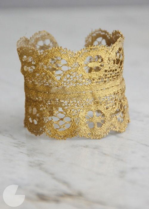 DIY Gold Lace Cuff Tutorial by Runway DIY here. *I've posted lace crowns and clothing that use different techniques for stiffening and coloring the lacehere,here and here.