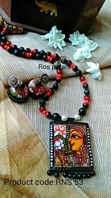 Kerala mural Lakshmi jewellery from Ros petals. Its fully hand painted on terracotta.