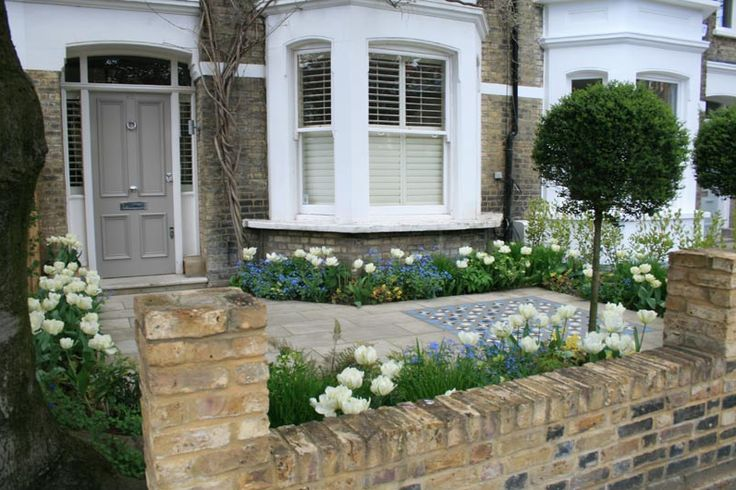 Paved front garden, victorian tiled area, tulips and trees