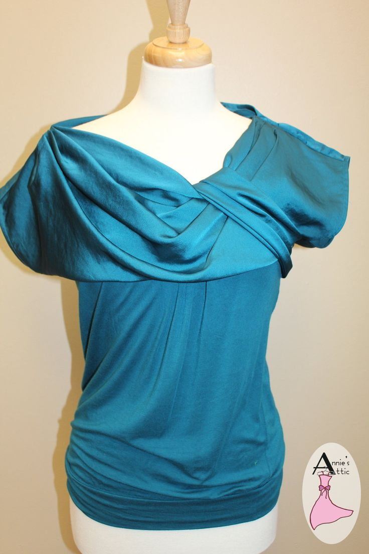 Ann Taylor shirt, size SMALL Pulls over head with knotting affect at neckline for a sophisticated look Banding at the bottom of the shirt Top of shirt is polyester, bottom is rayon/spandex blend $14.00