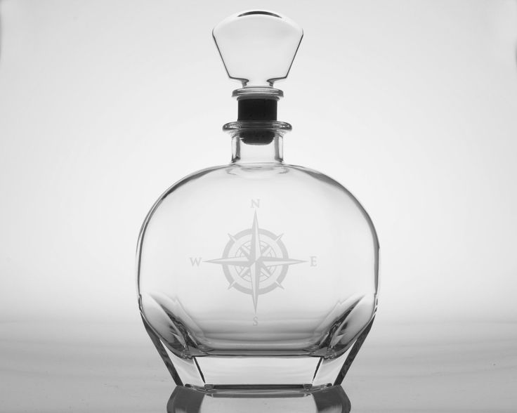 Our new beautifully etched 23 oz. whiskey decanter with a detailed compass rose symbol is perfect to serve or store cognac or single malt Scotch whiskey. Timeless, and elegant piece to add to your nau
