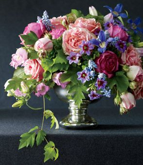 "Classic    A girly gathering of pink and purple blooms is always romantic.   Trailing grape ivy frames this sweet mélange of Finesse, Pierre de Ronsard, and Dorben roses combined with clematis, campanula, muscari, geraniums, and leucocoryne. ""Classic"" floral design by Lewis Miller, LMD Floral Events Interiors, NYC."