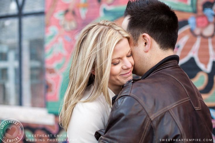 Engagement photos in front of Liberty Village murals. Toronto couples photography #sweetheartempirephotography