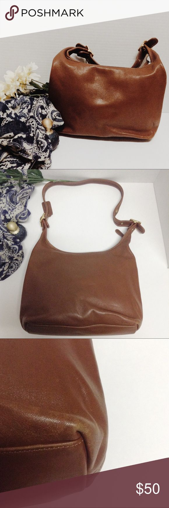 "Vintage Coach legacy tan brown hobo bag Vintage Coach legacy tan brown hobo bag. Good condition. Has some wear on the corners as pictured above. Super soft quality leather. Measurements: height:12"" width:4.5"" length: 11"" length from top of strap to bottom:23"" Coach Bags Hobos"