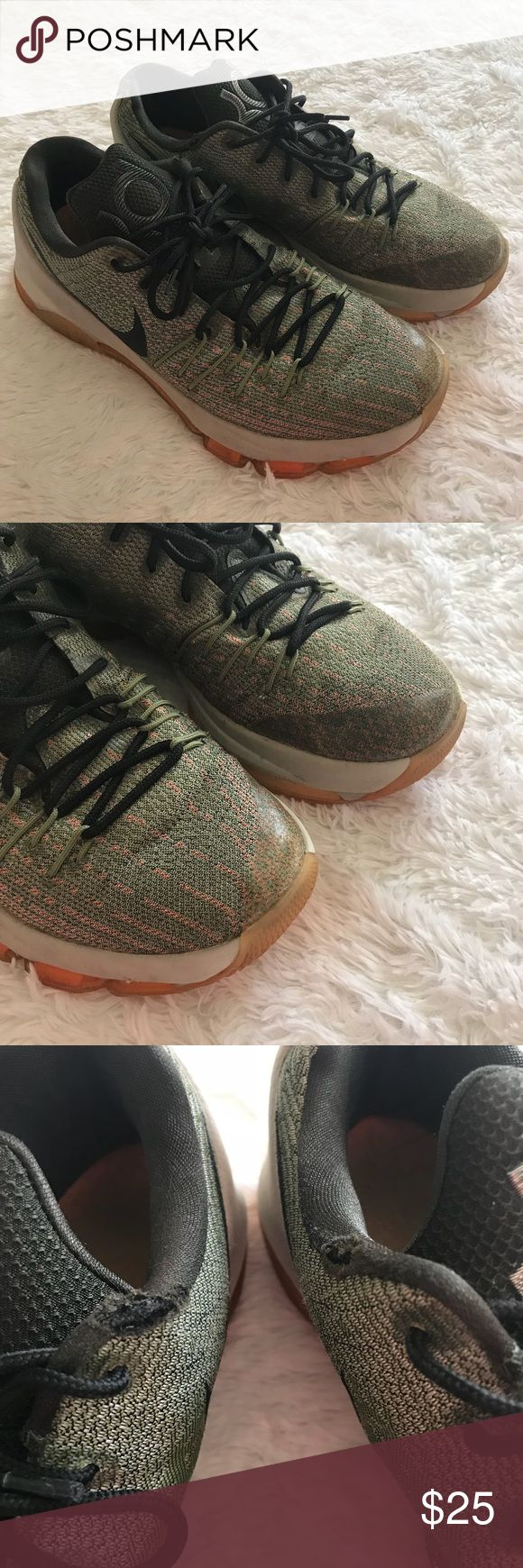 KD Nike Mens Sneakers Size 9 KD Nike Mens Sneakers  Size 9  Few flaws that i showed in pictures. Around opening there is a tear on each shoe but it is not noticeable when sneaker is on. Over all the sneakers are in great shape.  Colors Green Black Gray Orange Nike Shoes Sneakers