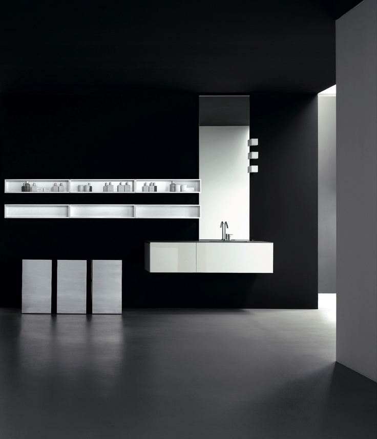 KUBIK 59 - Composition lacquered L58 Bianco glossy brushed. Top F10 marble resin Gris Serena. Ceramic inset washbasin mod. Rettangolare. Base unit on wheels lacquered L58 Bianco lucido covered with steel.