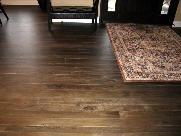 Located Near Bayfield Ontario - Scraped top grey elm flooring, random wide plank, and custom stained.  Installed and finished by Revival Flooring.